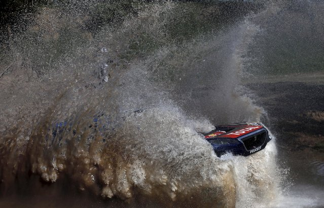 Sebastien Loeb of France drives his Peugeot through the water during the Buenos Aires-Rosario prologue stage of Dakar Rally 2016 in Arrecifes, Argentina, January 2, 2016. (Photo by Marcos Brindicci/Reuters)