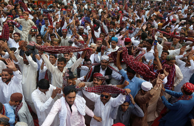 Men wave shawls, locally known as Ajrak, as they dance during Sindh Culture Day in Karachi, Pakistan, December 4, 2016. (Photo by Akhtar Soomro/Reuters)