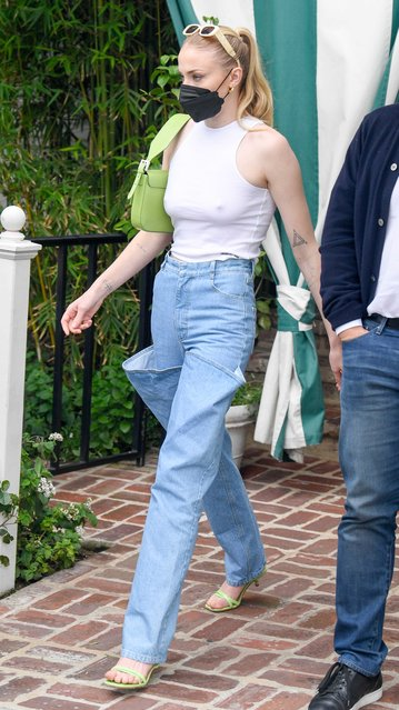 English actress Sophie Turner and Joe Jonas are pictured stepping out in Los Angeles on April 21, 2021. Turner, 25, wore a black face mask, white tank top, jeans with unusual pockets on the front, green heels, and a matching handbag. (Photo by TheImageDirect)