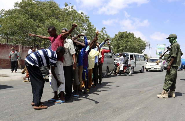 Somali security forces inspect civilians on the streets during an operation against suspected militant Islamist group al Shabaab following renewed killing of government officers and workers in the capital Mogadishu, February 18, 2015. (Photo by Feisal Omar/Reuters)