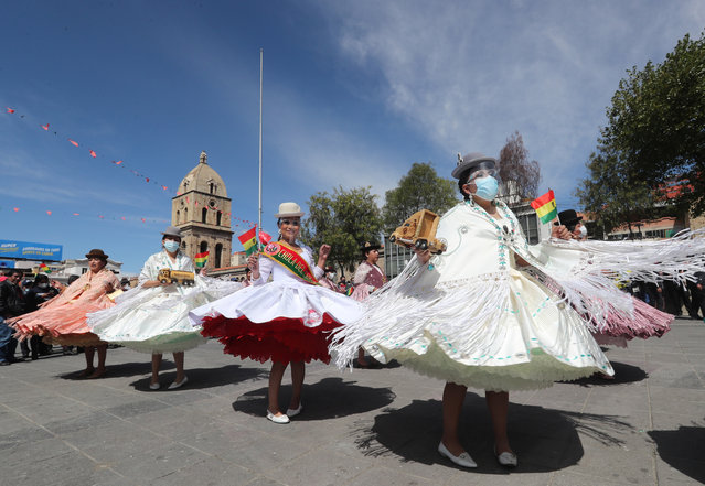 """A group of dancers perform the Morenada dance in the Plaza de San Francisco in La Paz, Bolivia, 12 May 2021. Bolivia announced this 12 May the formation of a committee for the safeguarding of dances such as the morenada and the caporales, also preparing demonstrations and festivals to preserve the """"identity"""" of the country's heritage, before the declaration of the Morenada as Cultural Heritage of Puno in Peru. (Photo by Martin Alipaz/EPA/EFE)"""