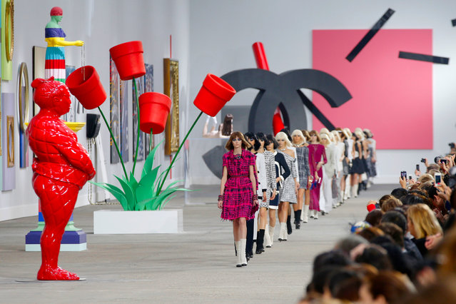 Models present creations as part of Chanel's ready-to-wear Spring/Summer 2014 fashion collection, presented Tuesday, October 1, 2013 in Paris. (Photo by Christophe Ena/AP Photo)