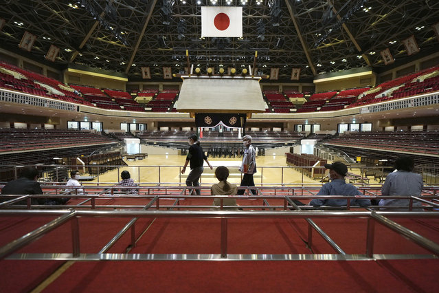 Elderly residents of Sumida Ward rest at box seats after receiving their first dose of Pfizer's COVID-19 vaccine at the Ryogoku Kokugikan sporting arena, in Tokyo Monday May 24, 2021. The arena, mainly used for sumo wrestling tournaments, is used as temporary inoculation venue for local residents age over 65 years old. (Photo by Eugene Hoshiko/AP Photo)