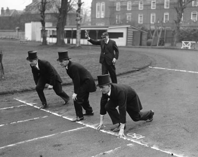 "Cambridge policemen, known as ""Bulldogs"", lined up for the University Bulldogs Chase, dressed in morning coats and top hats, 7th March 1936. (Photo by H. Allen/Topical Press Agency/Getty Images)"