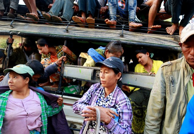 A vehicle carrying refugees from Laukkai arrives at temporary refugee camp in a monastery, in Lashio February 19, 2015. (Photo by Soe Zeya Tun/Reuters)