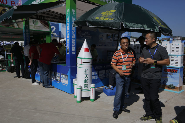 A rocket shape post box is displayed during the 12th China International Aviation and Aerospace Exhibition, also known as Airshow China 2018, Tuesday November 6, 2018, in Zhuhai city, south China's Guangdong province. (Photo by Kin Cheung/AP Photo)