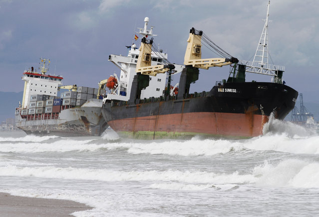 Two cargo ships lie stranded close to the shore after a heavy rainstorm in Valencia, September 29, 2012. (Photo by Heino Kalis/Reuters)