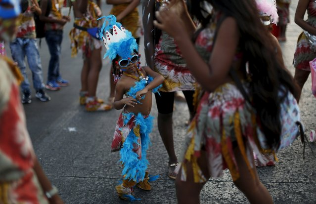 A young reveller enjoys the last day of the annual Carnival parade in Panama City February 9, 2016. (Photo by Carlos Jasso/Reuters)