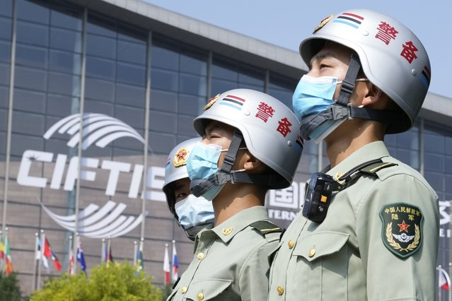 Security personnel stand guard outside the China International Fair for Trade in Services (CIFTIS) in Beijing on China, Thursday, September 2, 2021. Chinese and foreign enterprises are expected to showcase their latest technology and services during the annual China International Fair for Trade in Services this week. (Photo by Ng Han Guan/AP Photo)