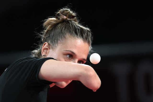 Natalia Partyka of Poland in action during the doubles match with Karolina Pek of Poland against Bruna Costa Alexandre and Danielle Rauen of Brazil in women's team table tennis classes 9-10 semifinal at Tokyo Metropolitan Gymnasium in Tokyo, Japan on September 1, 2021. (Photo by Bernadett Szabo/Reuters)