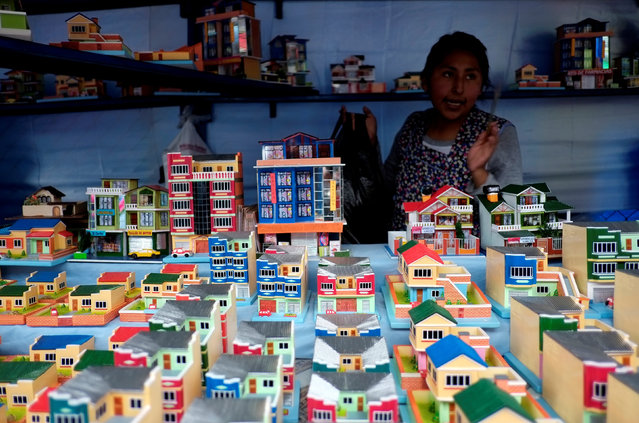 """Miniature houses are seen during the """"Alasitas"""" fair, where people buy miniature versions of goods they hope to acquire in real life, in La Paz, Bolivia, January 24, 2017. (Photo by David Mercado/Reuters)"""