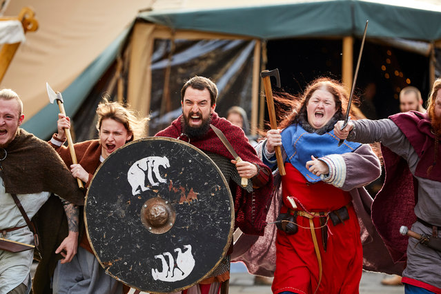 Viking re-enactors representing the rival armies of the Vikings and Anglo-Saxons skirmish near Clifford's Tower during the Jorvik Viking Festival on February 23, 2019 in York, England. (Photo by Christopher Thomond/The Guardian)