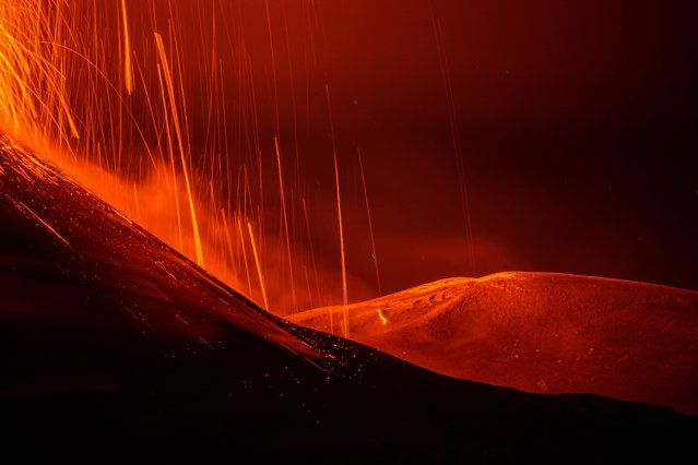 Streams of red hot lava flow as Mount Etna, Europe's most active volcano, erupts, as seen from Sant'Alfio, Italy, July 7, 2021. (Photo by Marco Restivo/Etna Walk/Handout via Reuters)