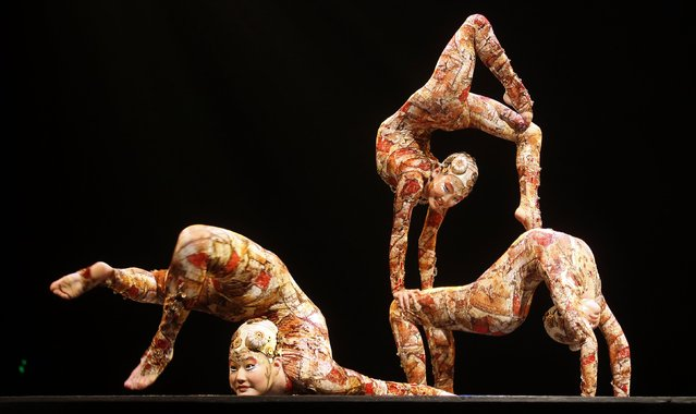 Contortion artists perform during the Cirque du Soleil's Kooza show in Madrid, in this file photo taken February 28, 2013. Founder Guy Laliberté has agreed to sell control of Cirque du Soleil, the world's largest theatrical production company, for about $1.5 billion, the Globe and Mail reported, citing sources familiar with the matter. (Photo by Sergio Perez/Reuters)