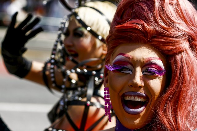 Men wear drag costumes as they take part in the Tokyo Rainbow Pride parade in Tokyo April 26, 2015. (Photo by Thomas Peter/Reuters)