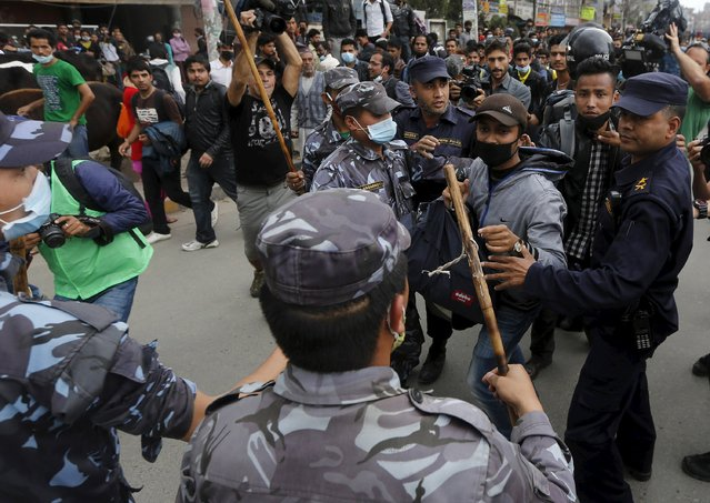 Earthquake victims scuffle with Nepalese police personnel as they try to block traffic along a road, while protesting against the government's lack of aid provided to the victims in Kathmandu, Nepal April 29, 2015. (Photo by Adnan Abidi/Reuters)