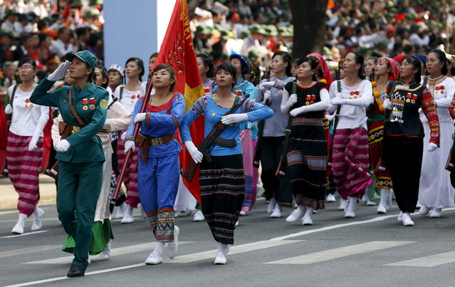 Female members of the ethnic minorities militia force march during a military parade as part of the 40th anniversary of the fall of Saigon in Ho Chi Minh City, April 30, 2015. (Photo by Reuters/Kham)