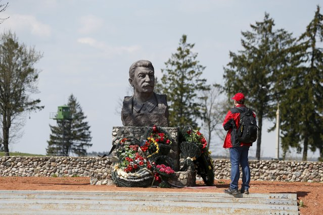 """A man stands at the monument of Soviet leader Joseph Stalin at the """"Stalin Line"""" memorial, near the village of Goroshki, west of Minsk, May 5, 2015. (Photo by Vasily Fedosenko/Reuters)"""