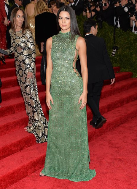 """Kendall Jenner arrives at The Metropolitan Museum of Art's Costume Institute benefit gala celebrating """"China: Through the Looking Glass"""" on Monday, May 4, 2015, in New York. (Photo by Evan Agostini/Invision/AP Photo)"""