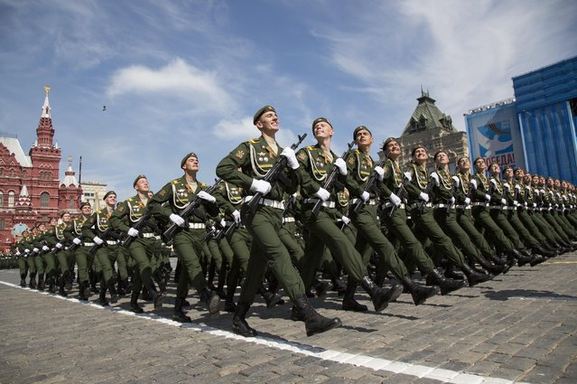Russian soldiers march during the Victory Parade marking the 70th anniversary of the defeat of the Nazis in World War II, in Red Square in Moscow, Russia, Saturday, May 9, 2015. (Photo by Alexander Zemlianichenko/AP Photo)
