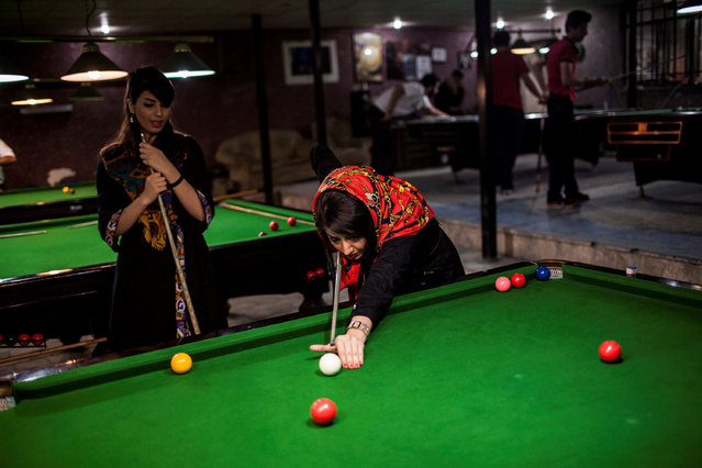 Iran: An Iranian Journey by Hossein Fatemi. Women play pool in a men only gym, which it is forbidden for women to enter. (Photo by Hossein Fatemi/Reuters/Panos Pictures/Courtesy of World Press Photo Foundation)