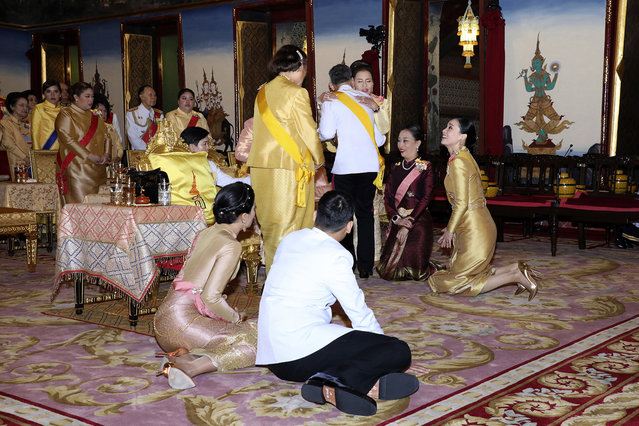 In this Friday, May 3, 2019, photo released by Bureau of the Royal Household, Thailand's King Maha Vajiralongkorn, center, hugs his sister Princess Ubolratana, with Royal family and Queen Suthida, sitting at right, before make the religious ceremony at Grand Palace in Bangkok, Thailand. The coronation ceremony for 66-year-old King Maha Vajiralongkorn, also known as King Rama X, will be held on May 4-6, 2019. (Photo by Bureau of the Royal Household via AP Photo)