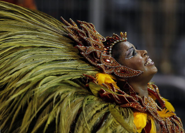 A reveller from the Vai Vai samba school takes part in the first night of the Special Group category of the annual Carnival parade in Sao Paulo's Sambadrome March 1, 2014. (Photo by Paulo Whitaker/Reuters)