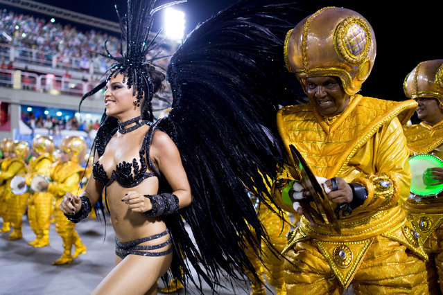 Queen of Percussion Mariana Rios and members of Mocidade Samba School during its parade at 2014 Brazilian Carnival at Sapucai Sambadrome on March 03, 2014 in Rio de Janeiro, Brazil. (Photo by Buda Mendes/Getty Images)