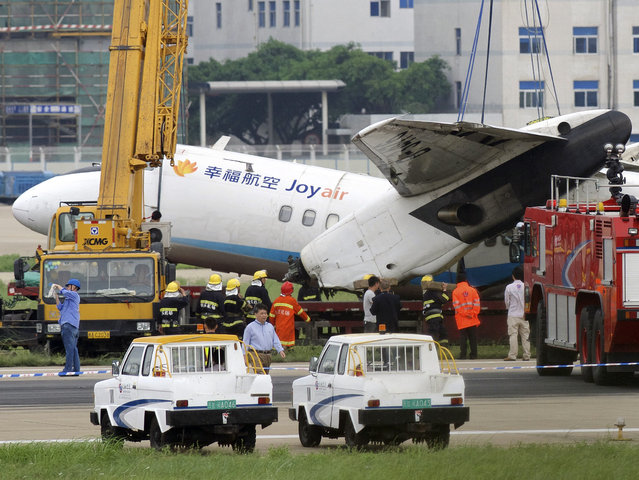 In this photo released by China's Xinhua News Agency, rescuers work at the accident site at Changle International Airport in Fuzhou, capital of southeast China's Fujian Province Sunday, May 10, 2015. A plane operated by Chinese domestic carrier Joyair veered off a runway upon landing in the southeastern city of Fuzhou on Sunday, the airline said. (Photo by Jiang Kehong/Xinhua via AP Photo)