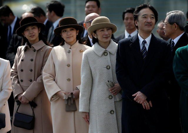 Japan's Prince Akishino (R), his wife Princess Kiko (2nd L) and thier daughters Princess Mako (2nd L) and Princess Kako send off Emperor Akihito and Empress Michiko boarding a special flight for their visit to the Vietnam and Thailand, at Haneda Airport in Tokyo, Japan February 28, 2017. (Photo by Issei Kato/Reuters)