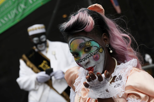 A member of the New Orleans Baby Doll Ladies blows a kiss during the Krewe of Zulu parade at Mardi Gras in New Orleans, Louisiana U.S., February 28, 2017. (Photo by Shannon Stapleton/Reuters)