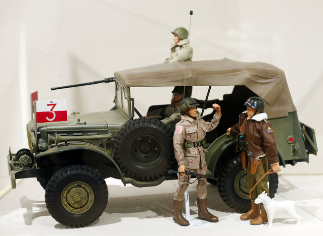 This January 31, 2014 photo shows a Gen. George Patton G.I. Joe action figure, right, and other G.I. Joes in a display at the New York State Military Museum  in Saratoga Springs, N.Y. A half-century after the 12-inch doll was introduced at a New York City toy fair, the iconic action figure is being celebrated by collectors with a display at the military museum, while the toy's maker plans other anniversary events to be announced later this month. (Photo by Mike Groll/AP Photo)