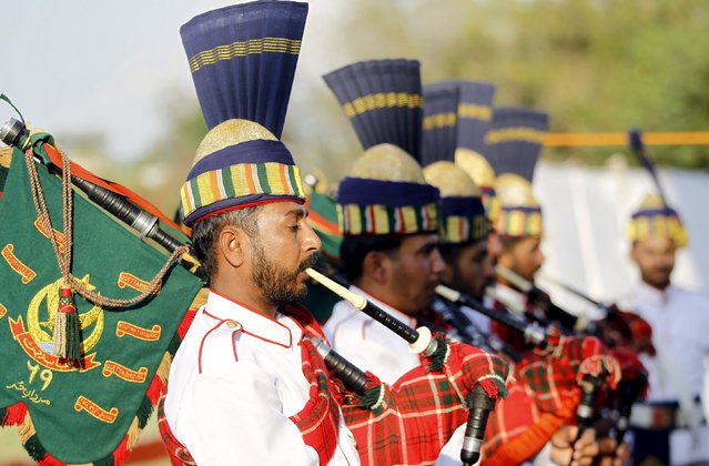 A military band plays the bagpipes during the finals of the Murree Brewery Cup polo tournament in Rawalpindi April 12, 2015. Picture taken April 12, 2015. (Photo by Caren Firouz/Reuters)