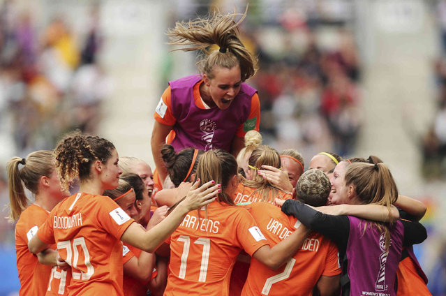 Netherlands players celebrate Netherlands' Anouk Dekker scoring the opening goal during the Women's World Cup Group E soccer match between the Netherlands and Canada at Stade Auguste-Delaune in Reims, France, Thursday, June 20, 2019. (Photo by Francisco Seco/AP Photo)