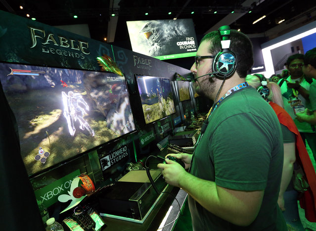 E3 2015 attendees get hands on with Fable Legends at the Xbox booth at E3 in Los Angeles on Tuesday, June 16, 2015. (Photo by Casey Rodgers/Invision for Microsoft/AP Images)