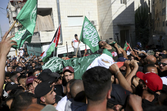 Mourners carry the body of Mohammed Obeid, a 20 year-old Palestinian killed in a clash with Israeli police on June 27, during his funeral in east Jerusalem, Monday, July 1, 2019. (Photo by Mahmoud Ilean/AP Photo)