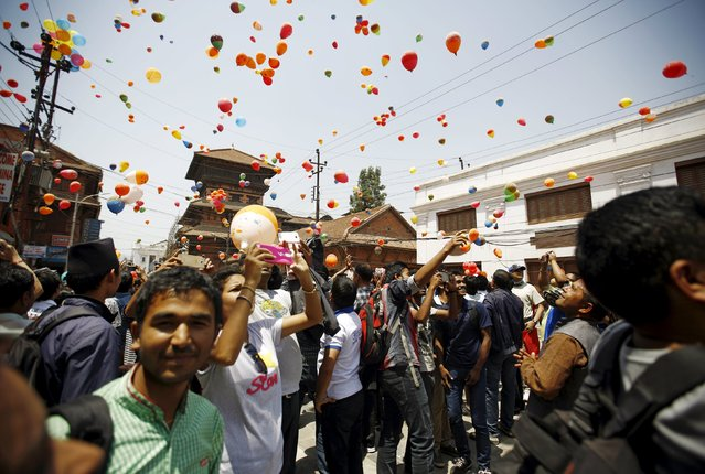 People release balloons during an event organized to commemorate the victims of last year's earthquakes in Kathmandu, Nepal, April 23, 2016. (Photo by Navesh Chitrakar/Reuters)
