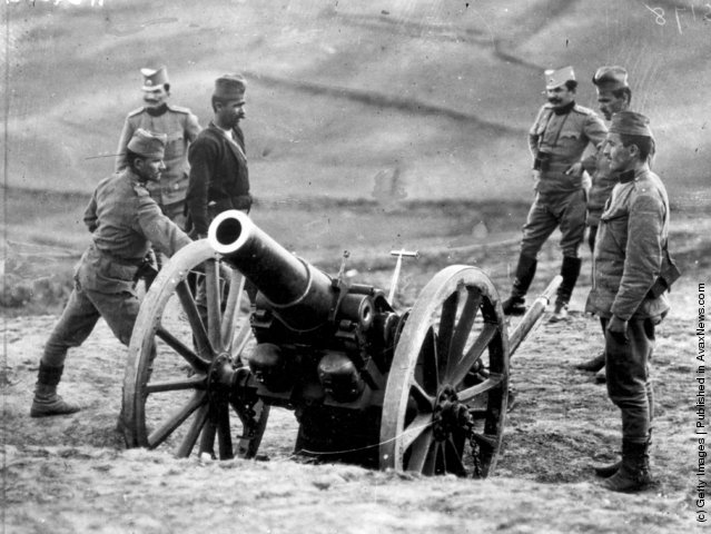 1915: Serbian officers with a Howitzer battery as they prepare to fire on Austrians, during the First World War