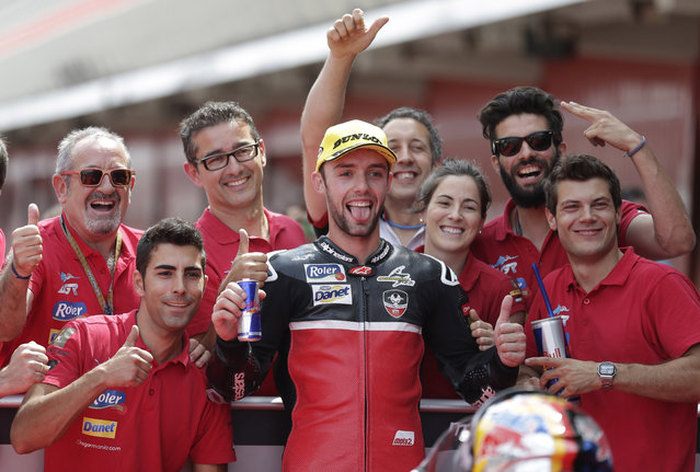 Moto2 rider Jonas Folger gestures after clocking the second fastest time for Sunday's Spanish Motorcycling, in Montmelo, Spain, Saturday, June 13, 2015. The Catalunya Grand Prix will take place on Sunday in Montmelo. (AP Photo/Manu Fernandez)