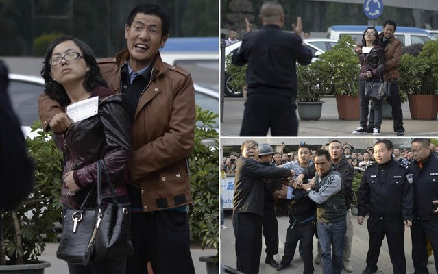 Chinese police officers arrest a cleaver-wielding man, who took a woman hostage, in front of the Kunming News Center in Kunming city, southwest Chinas Yunnan province, 8 April 2014. A woman taken hostage by a cleaver-wielding man was rescued unharmed by police at the Kunming News Center in southwest Chinas Yunnan Province on Tuesday. (Photo by Reuters)
