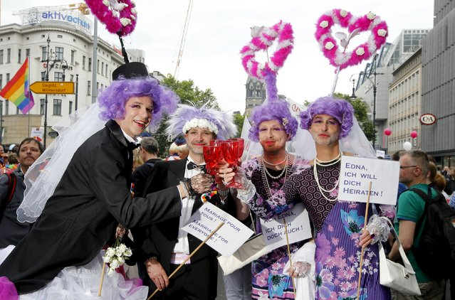 People participate dressed as married couples in the annual Christopher Street Day parade on Kurfuerstendamm in Berlin, Germany, June 27, 2015. (Photo by Fabrizio Bensch/Reuters)