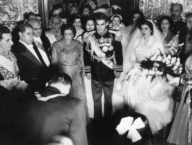 1951:  Muhammad Reza Shah Pahlavi (1919 - 1980), the Shah of Iran, at his wedding flanked by his bride and mother
