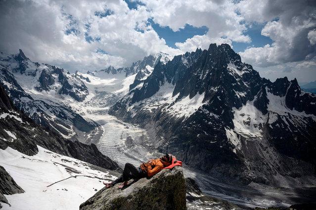 Aspiring Mountain guide Yann Grava takes a rest near the Mer de Glace glacier at the Charpoua Refuge (mountain hut) on June 19, 2019, in Chamonix. (Photo by Marco Bertorello/AFP Photo)