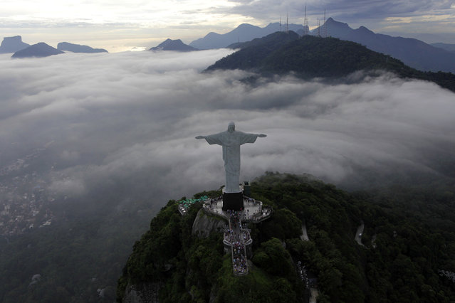 Rio de Janeiro: An aerial view of the famous Christ the Redeemer atop of Corcovado mountain in Rio de Janeiro, January 12, 2011. (Photo by Bruno Domingos/Reuters)
