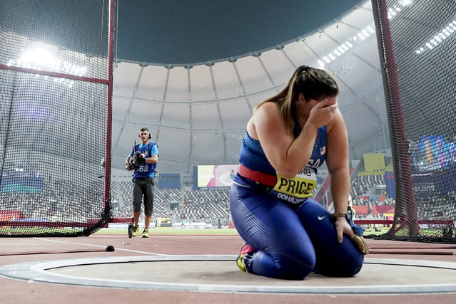 Deanna Price, of the United States, kneels at the throwing circle after winning the gold medal for the women's hammer throw at the World Athletics Championships in Doha, Qatar, Saturday, September 28, 2019. (Photo by David J. Phillip/AP Photo)