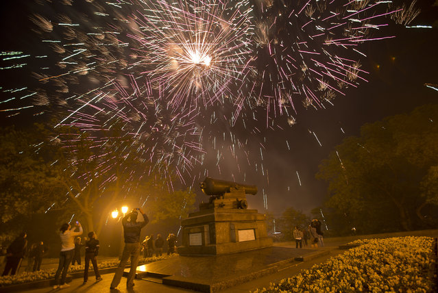 Fireworks light the sky at the end of Victory Day celebrations in Odessa, Ukraine, Friday, May 9, 2014. (Photo by Vadim Ghirda/AP Photo)