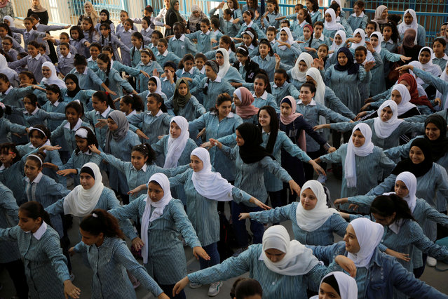Palestinian students participate in a morning activity at a United Nations-run school, on the first day of a new school year, in al-Fari'ah refugee camp in the Israeli-occupied West Bank on August 25, 2019. (Photo by Raneen Sawafta/Reuters)
