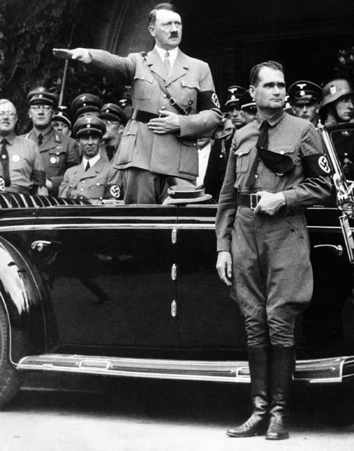 The December 30 1938 file photo shows German Chancellor Adolf Hitler and his personal representative Rudolf Hess, right, during a parade in Berlin, Germany. Minister of Propaganda Dr. Joseph Goebbels can be seen on the left side next to Hitler. The skeletal remains of Adolf Hitler's deputy Hess, have been removed from their grave in a small Bavarian town that had become a pilgrimage site for neo-Nazis. The administrator of the cemetery in Wunsiedel told The Associated Press on Thursday, July 21, 2011 that the bones were exhumed early Wednesday morning. (Photo by AP Photo)