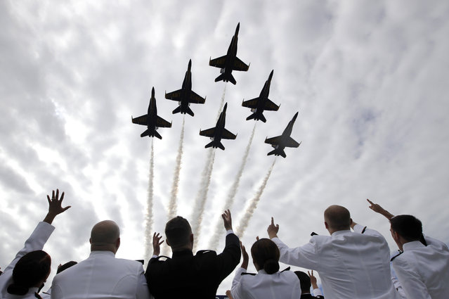 U.S. Navy Blue Angels fighter jets perform a flyover above graduating U.S. Naval Academy midshipmen during the Academy's graduation and commissioning ceremony in Annapolis, Md., Friday, May 26, 2017. (Photo by Patrick Semansky/AP Photo)