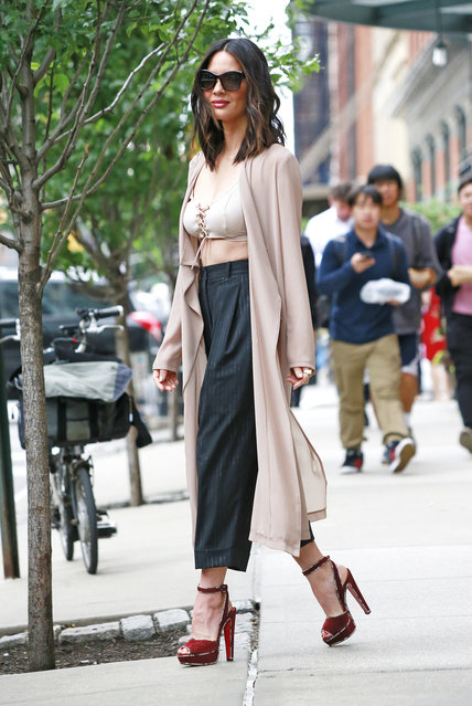 Olivia Munn wears a revealing corset style bra top while out and about in New York. New York City, NY on Wednesday, June 07, 2017. (Photo by PacificCoastNews)